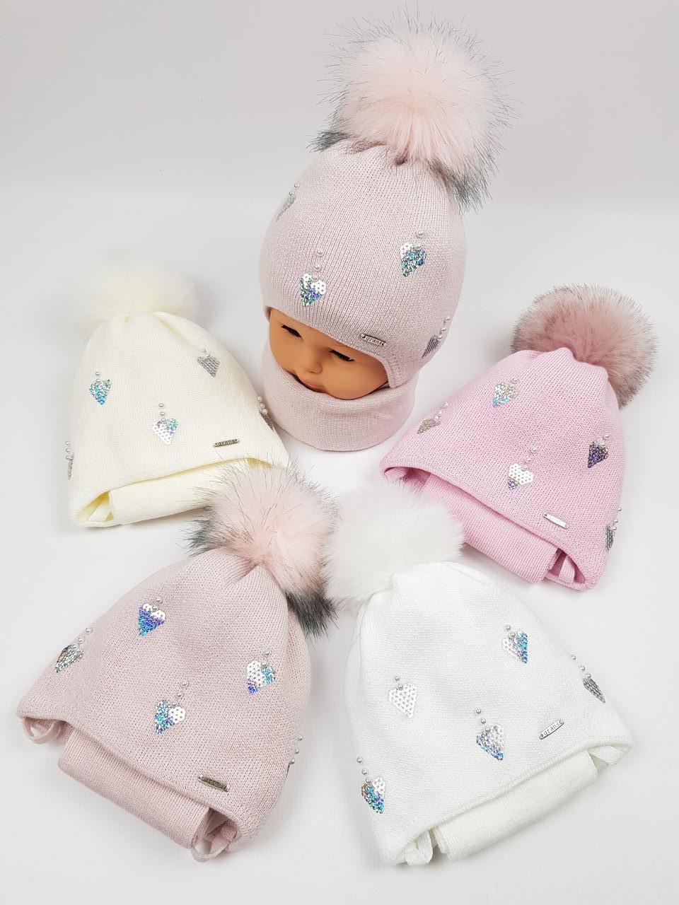 Дитячі польські зимові в'язані шапки на флісі з завязками і помпоном оптом для дівчат, р.44-46, Grans