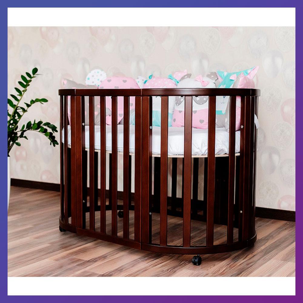 Детская кроватка-трансформер круглая овальная деревянная Angelo темный орех 2 положения по высоте маятник