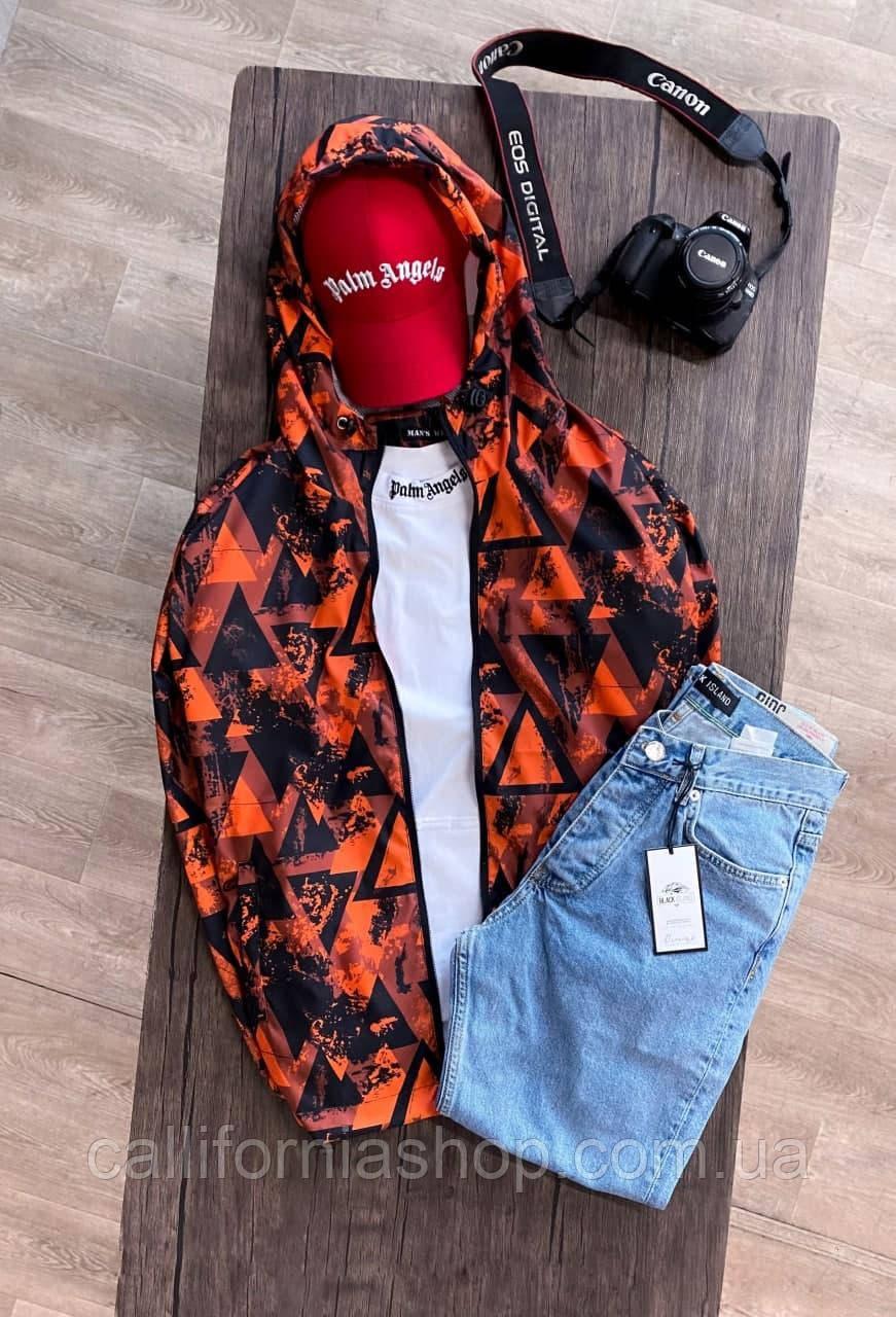 Вітрівка чоловіча помаранчева з геометричним принтом з капюшоном