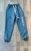 Подростковые спортивные штаны для мальчика на флисе на манжетах Reebok 8-12 лет, цвет голубой