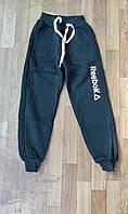 Подростковые спортивные штаны для мальчика на флисе на манжетах Reebok 8-12 лет, темно-синего цвета