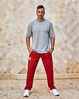 Чоловічі спортивні штани з кишенями вгорі на гумці і шнурку внизу прямі червоний