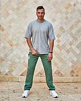 Чоловічі спортивні штани з кишенями вгорі на гумці і шнурку внизу прямі оливка