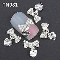 Бантик с камнями для дизайна ногтей. серебро Размер 9х12мм.Цена за 1шт
