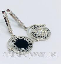 Родированые серебряные сережки на две стороны Бренд