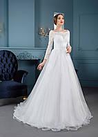 Аккуратное ажурное свадебное платье на длинный рукав со спинкой-капелькой