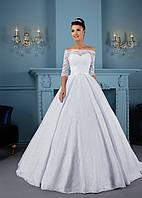 Превосходное свадебное платье с открытыми плечиками и поразительной юбкой с милым бантиком на талее