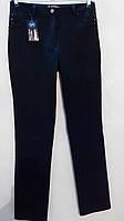 Брюки-джинсы больших размеров , темно-синего цвета.