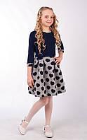 Трикотажное платье стильного кроя