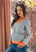Женская кофта с яркими оранжевыми вставками