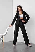 Строгий черный женский костюм с брюками и жакетом