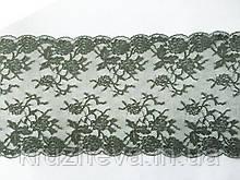 Стрейчевое (еластичне) мереживо оливкового кольору, шириною 21,5 див.