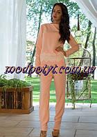 Женский кремовой костюм с гипюром