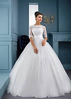 Изумительно нежное свадебное платье с элегантно сотканным верхом и красивой воздушной юбкой