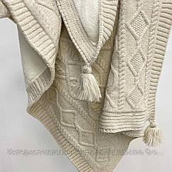Плед вязанный утепленный с кисточками бежевого цвета 95*85 см