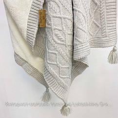 Плед вязанный утепленный с кисточками серого цвета  95*75 см