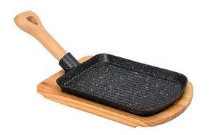 Сковорода чавунна на дерев'яній підставці з ручкою 230 * 180 мм (шт)