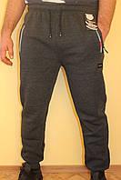 Спортивные брюки серые на флисе с карманами