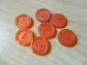 Набор оранжевых пуговиц