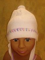Белая вязаная шапка на девочку, фото 1