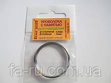 Проволока с памятью, цвет серебро, диаметр кольца 32 мм, диаметр стержня проволоки 0,6 мм.