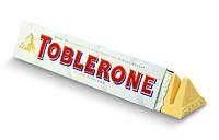 Белый шоколад Toblerone с медом, миндалем, нугой 100 gr