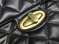 Замена поворотного замка на женской сумке