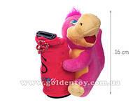 Динозаврик с мешком-копилкой муз. 16 см