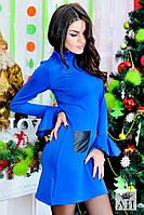 Женское платье с кожаными кармашками и воланами на руковах