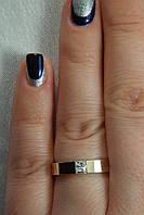 Оригинальное серебряное кольцо с золотом и фианитом