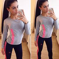Женский яркий спортивный костюм, кофта и брюки.
