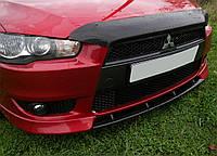 Вставка між іклами, накладка на бампер Mitsubishi Lancer X 2007-2010 р. в. глянець під фарбування