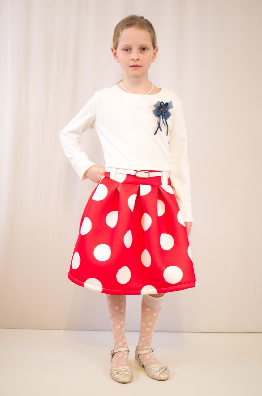 Детское оригинальное, нарядное платье  из фактурного трикотажа.