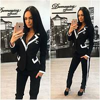 Стильный женский черно-белый брючный костюм e-3110153