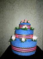 Торт трехъярусный из полотенец для лица и бани