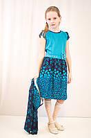 Красивое стильное платье и болеро с ярким принтом.