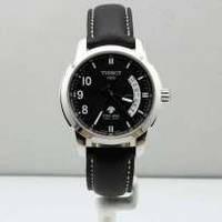 Мужские часы TISSOT кварцевые черный ремешок и циферблат три цифры с левой стороны корпус металл