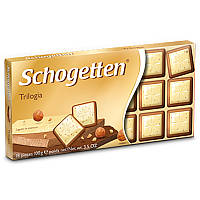 Шоколад молочно-белый Schogеtten Trilogia 100г Шогеттен трилогия с дробленным орехом 100г, фото 1