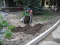 Насыпь плодородного слоя почвы