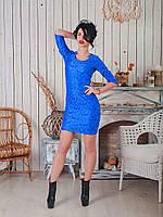 Красивое женское платье из нежной  ткани с цветочным узором.