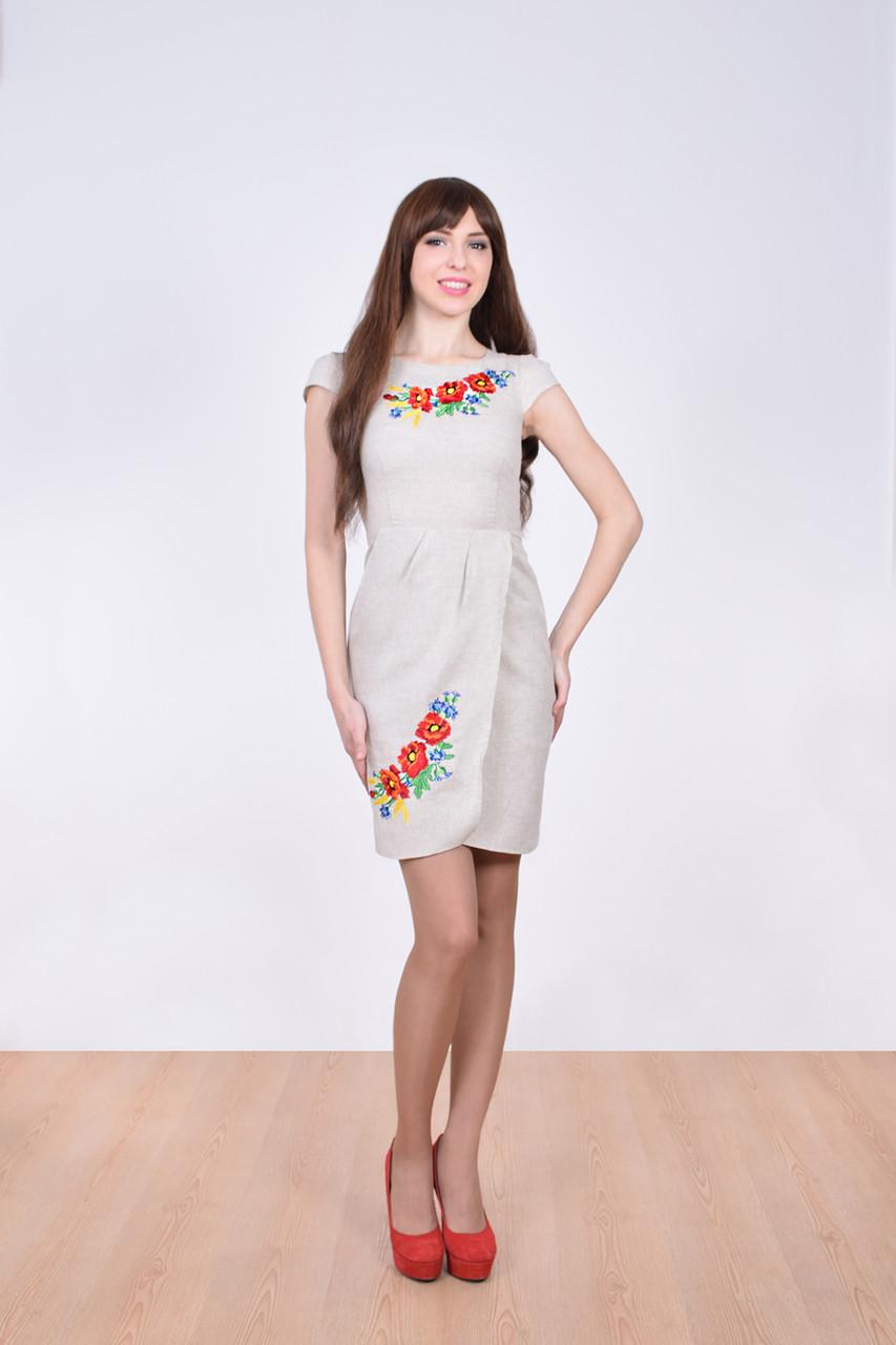 Очаровательное льняное платье приталенного кроя с вышивкой спереди
