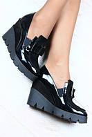 Женские  кожаные туфли на танкетке с бантиком