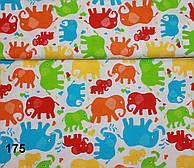 Ткань с цветными слонами: оранжевыми, голубыми (№175)