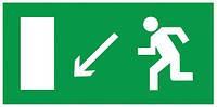 Самоклеящаяся этикетка: 100×50 мм, «Направление к эвакуационному выходу налево вниз», IEK