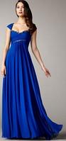Красивое шифоновое платье на корсете Украшено камнями.