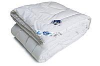 Двуспальное одеяло из иск. лебяжьего пуха, демисезонное.