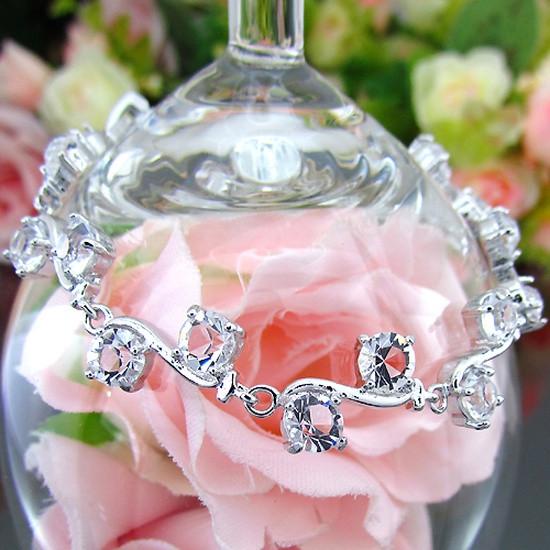 """Витончений жіночий браслет з прозорими каменями """"Рафаелло II"""" покриття біле золото"""