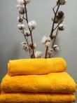 Махровое полотенце 50Х100 желтое 550