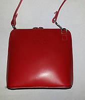 Кожаная сумка-клатч красного цвета