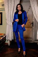 Женский костюм (пиджак на атласной подкладке,брюки)